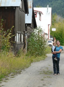 Denise and Isaiah. The Riversong restaurant and lodge are behind to the right